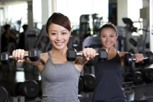 Young Women Lifting Weights