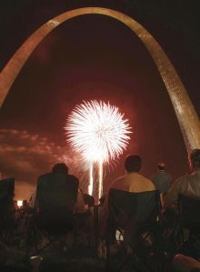 People watch fireworks at the Arch in St