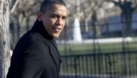 US President Barack Obama walks back to