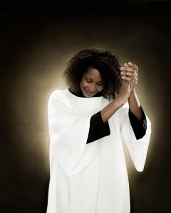 A gospel singer clapping
